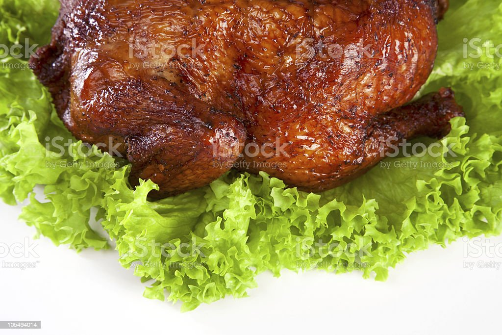 homemade hot smoked whole chicken on leaf lettuce stock photo