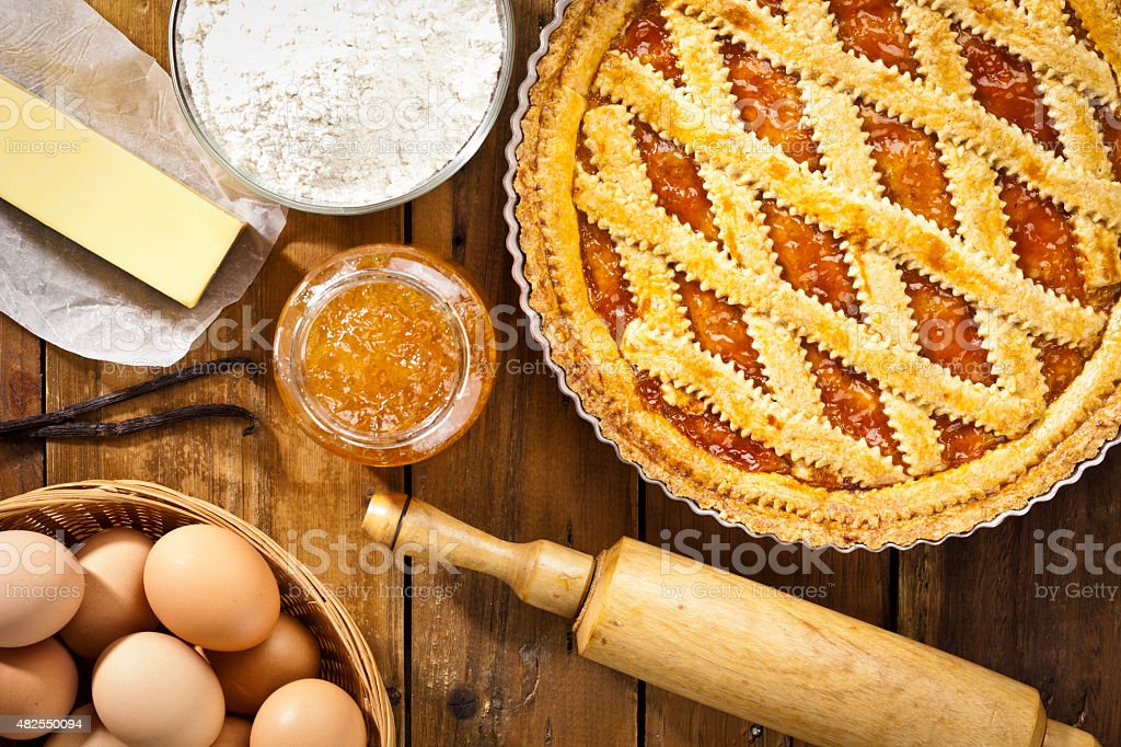 Homemade italian crostata with ingredients shot directly above stock photo