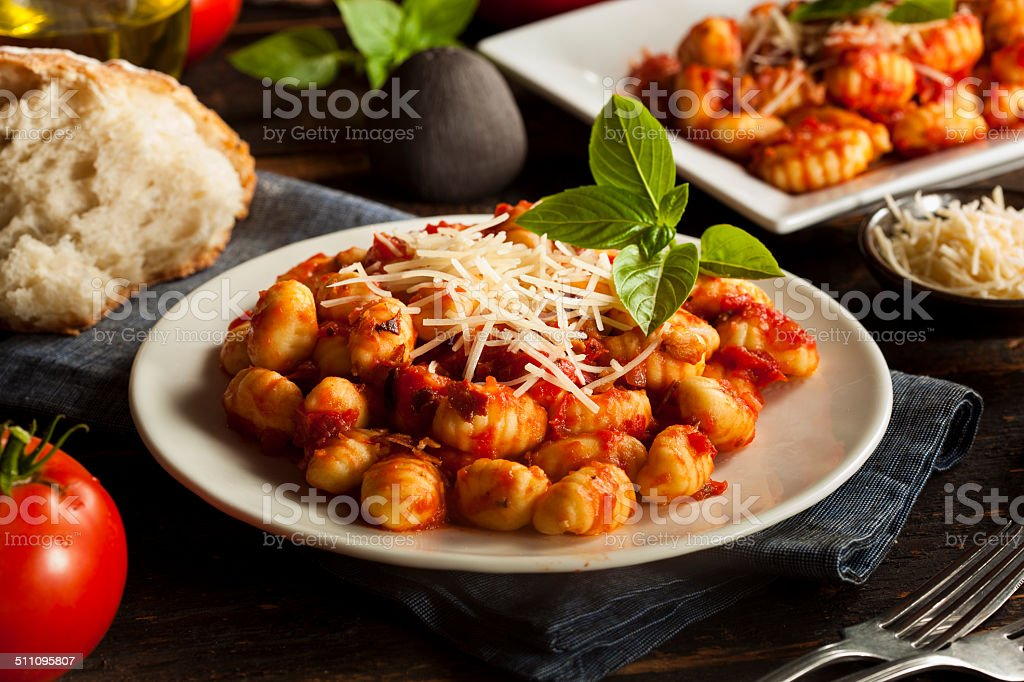 Homemade Italian Gnocchi with Red Sauce stock photo