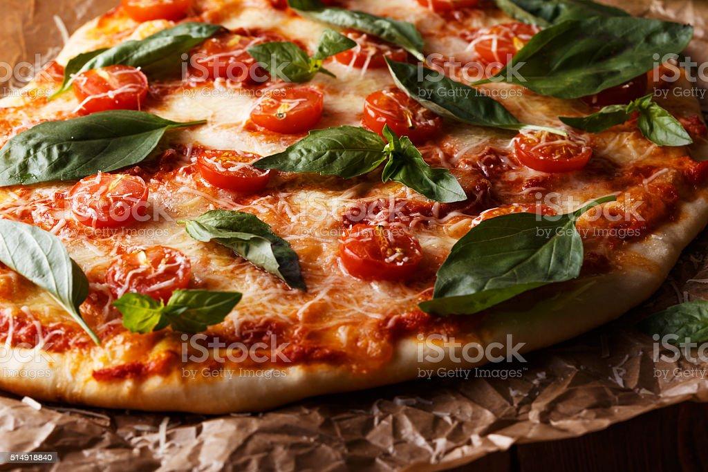 Homemade italian pizza with mozzarella, tomatoes and basil leaves. stock photo