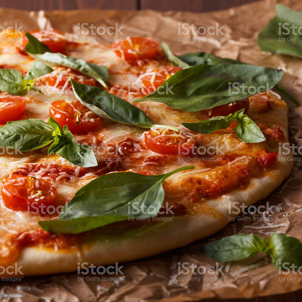 Homemade italian pizza with mozzarella, tomatoes and basil leaves. stock photo