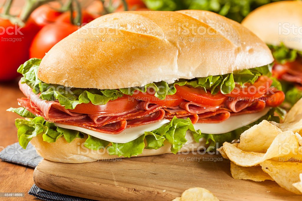 Homemade Italian sub sandwich with meats and veggies stock photo