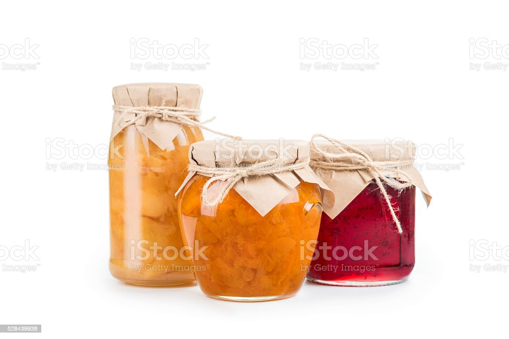 Three jars of homemade jam isolated
