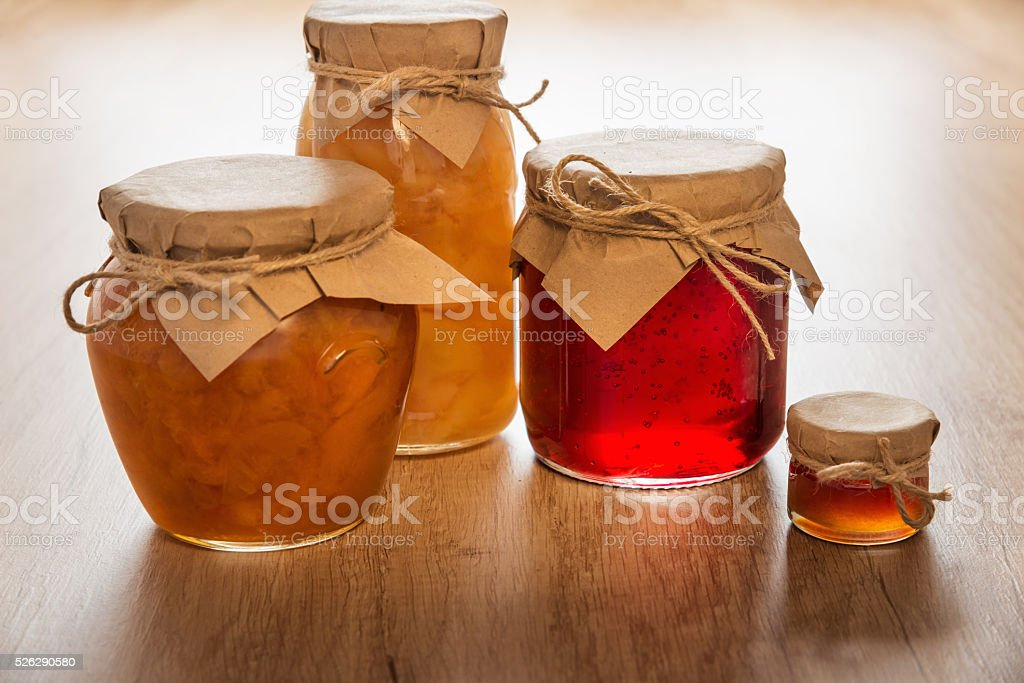 Homemade jam on wooden table stock photo