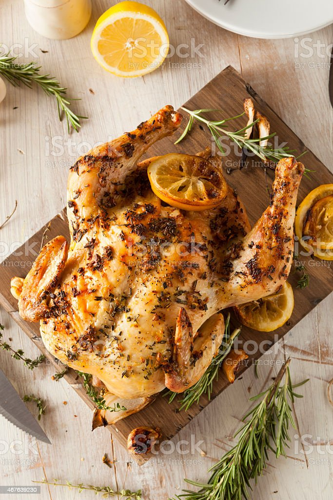 Homemade Lemon and Herb Whole Chicken stock photo