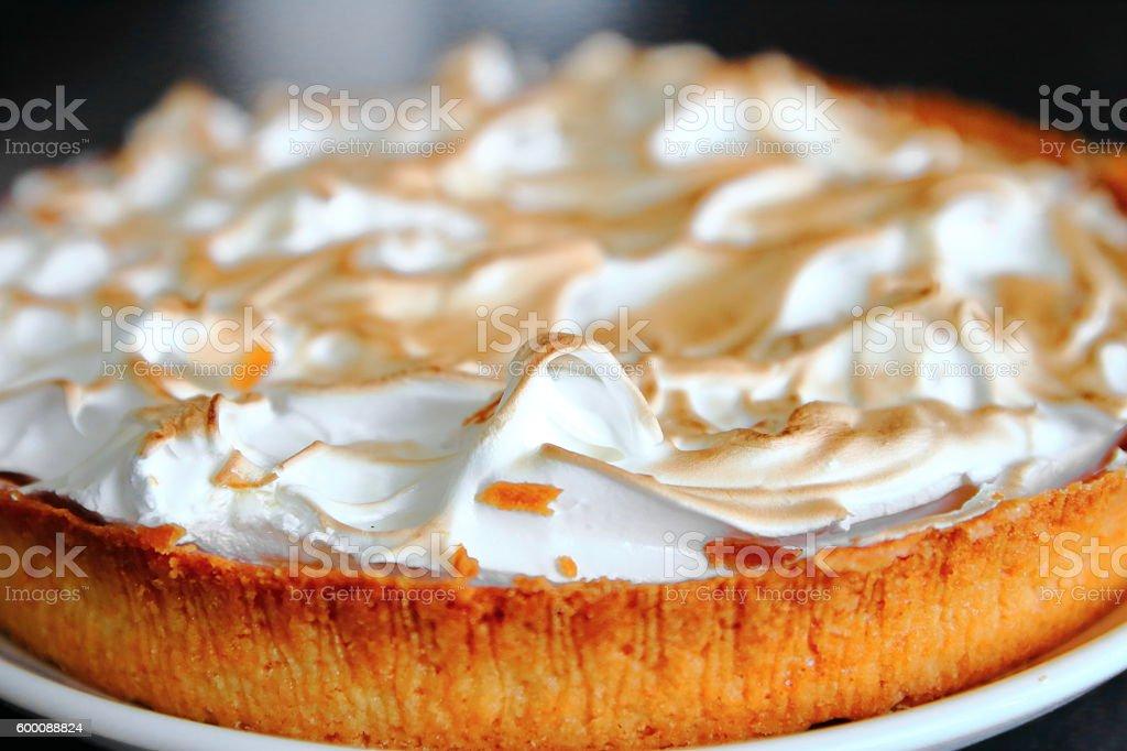 Homemade lemon meringue pie baked shot on dark kitchen island stock photo