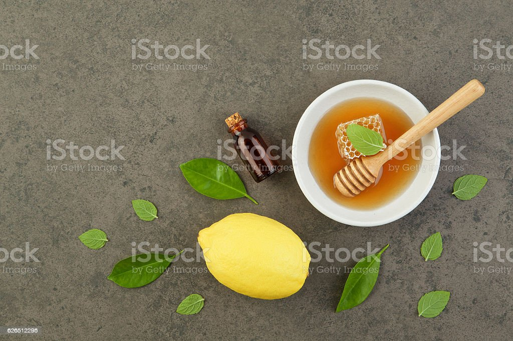 Homemade lemon salt bath and honey in plate with honey stock photo