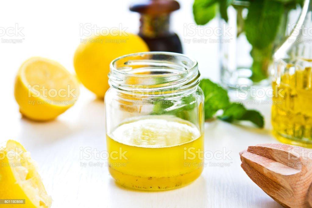 Homemade Lemon vinaigrette by fresh ingredients stock photo
