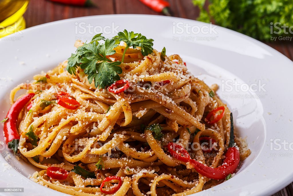 Homemade linguine pasta in arrabbiata sauce. stock photo