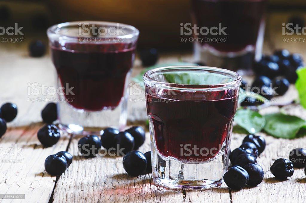 Homemade liqueur from aronia stock photo