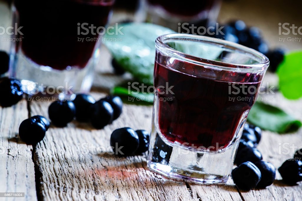 Homemade liqueur from aronia stock photo
