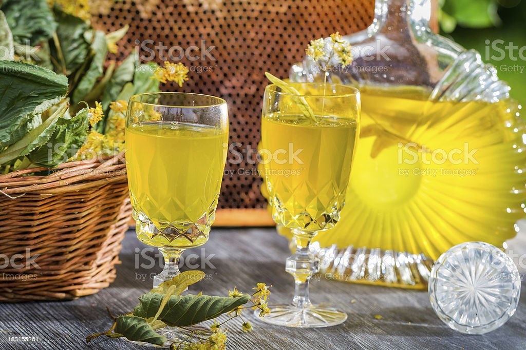 Homemade liqueur made of honey and dry lime leaves royalty-free stock photo