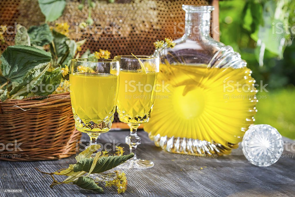 Homemade liqueur made of honey and lime in garden royalty-free stock photo