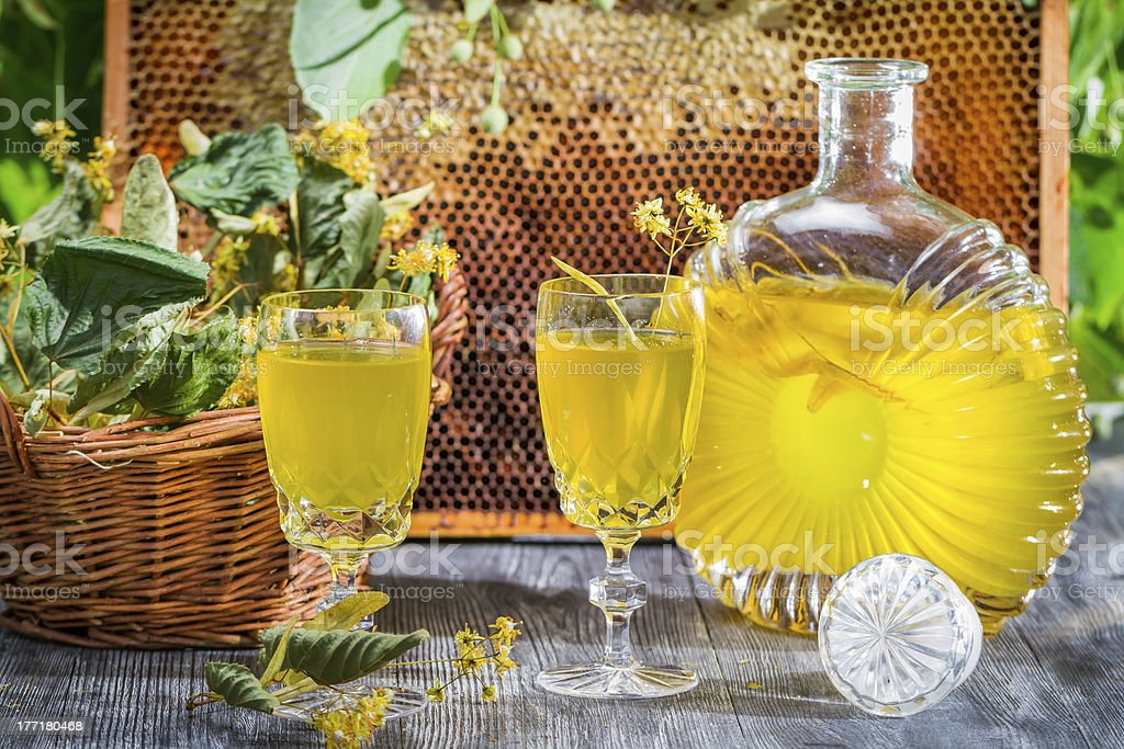 Homemade liqueur made of honey and lime royalty-free stock photo