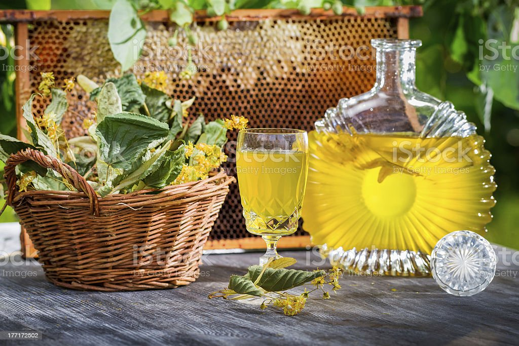 Homemade liqueur with lime and honey royalty-free stock photo
