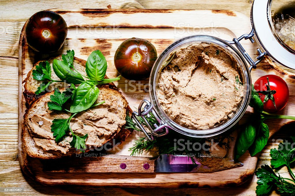Homemade liver pate in a glass jar and fried toast stock photo