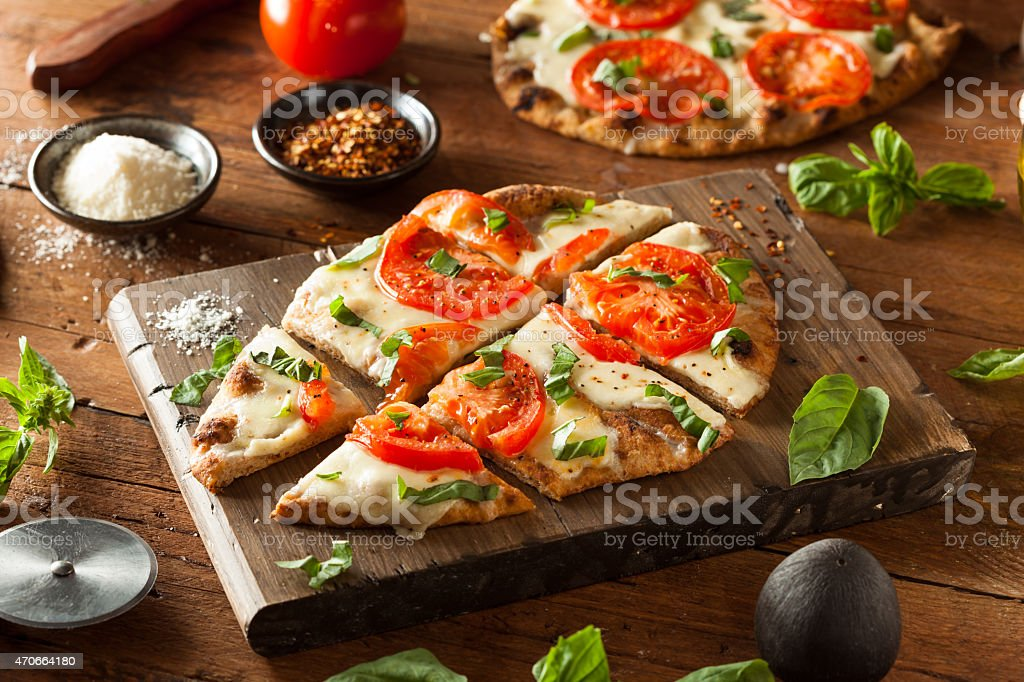 Homemade Margarita Flatbread Pizza stock photo