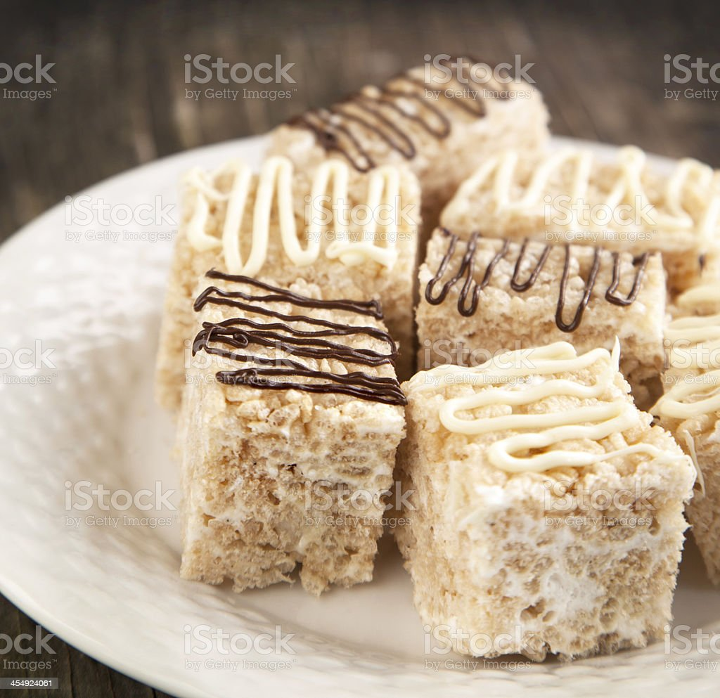 Homemade Marshmallow Rice Crispy Dessert Bar with chocolate stock photo