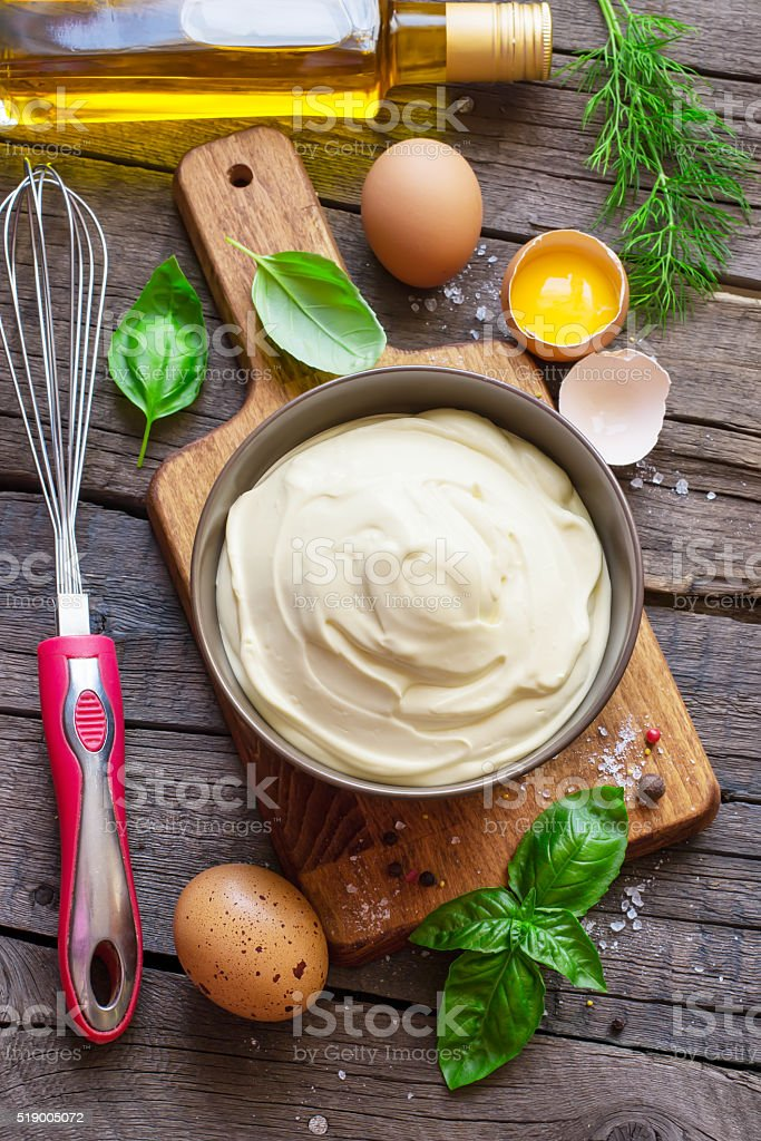 Homemade mayonnaise sauce and ingredients. Top view stock photo