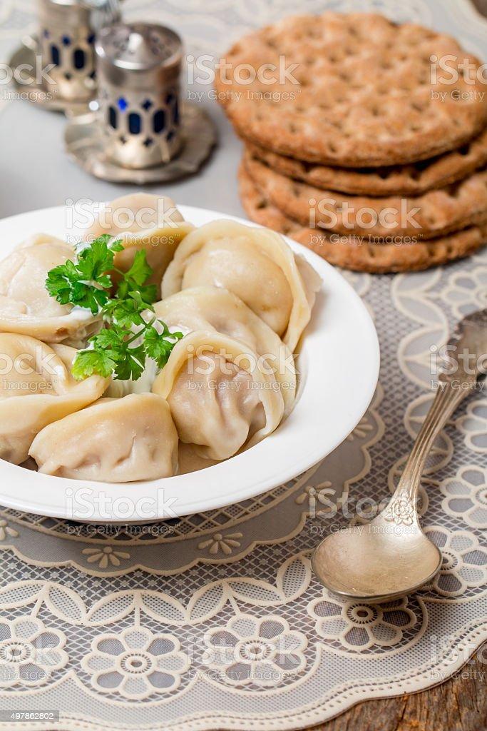 Homemade Meat Dumplings - russian pelmeni stock photo