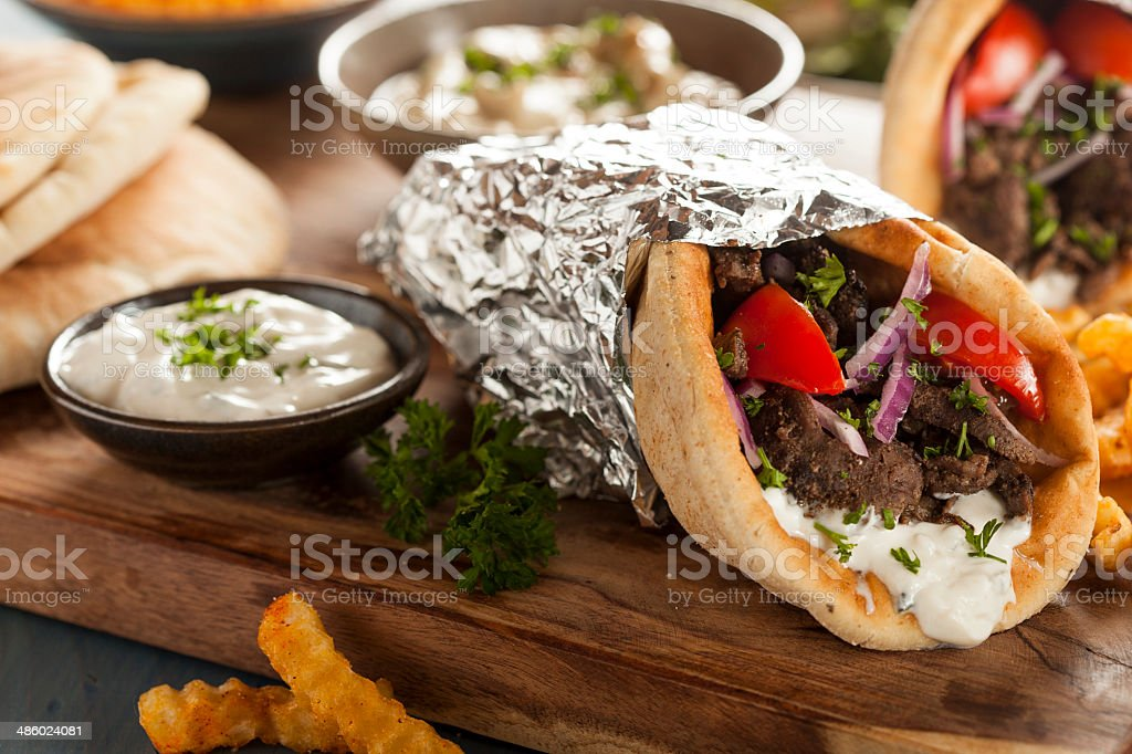 Homemade Meat Gyro with Tzatziki Sauce and French Fries stock photo