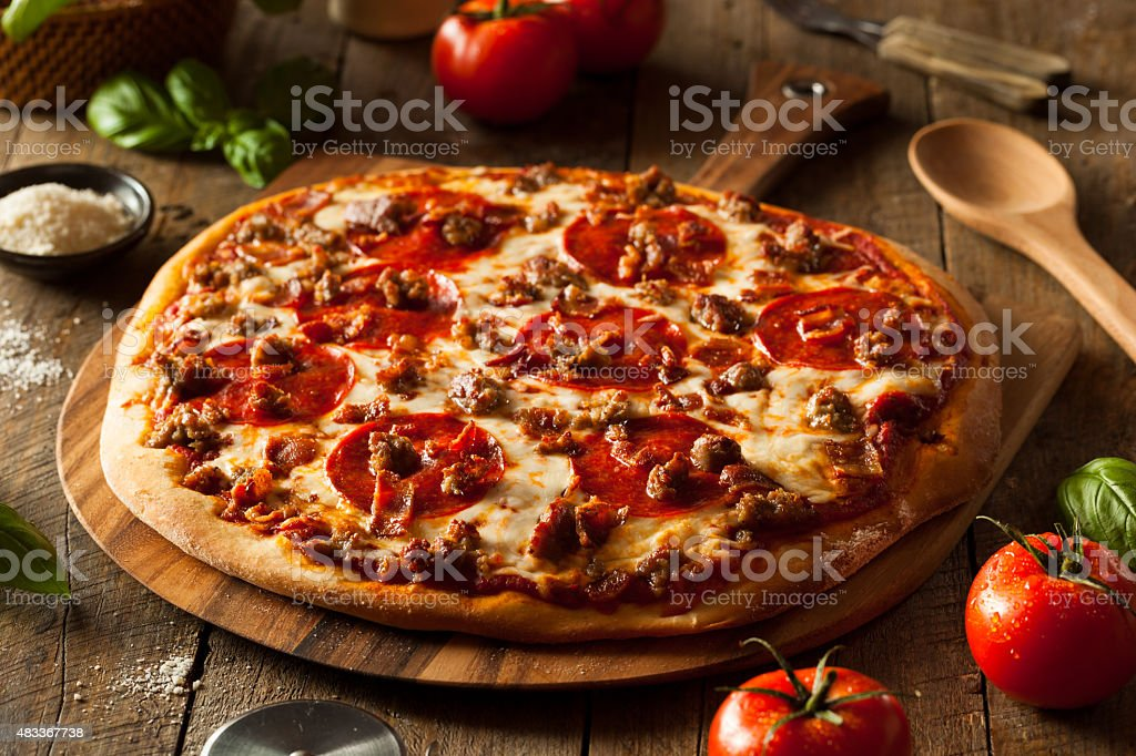 Homemade Meat Loves Pizza stock photo