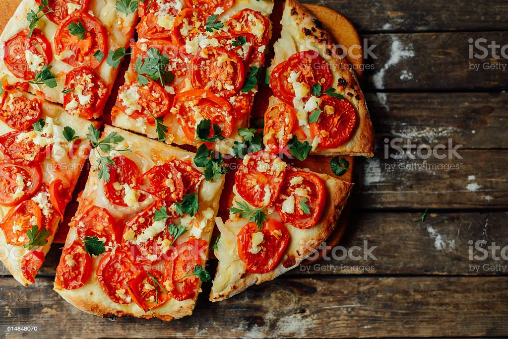 Homemade Meat Loves Pizza with Pepperoni Sausage and Bacon. Home stock photo