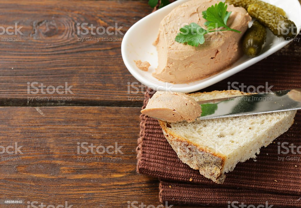 homemade meat pate with pickles and white bread stock photo