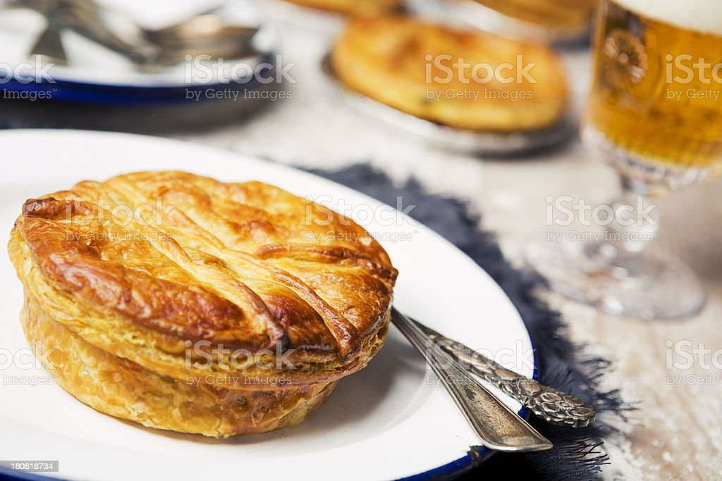 Homemade meat pie and beer on a rustic table stock photo