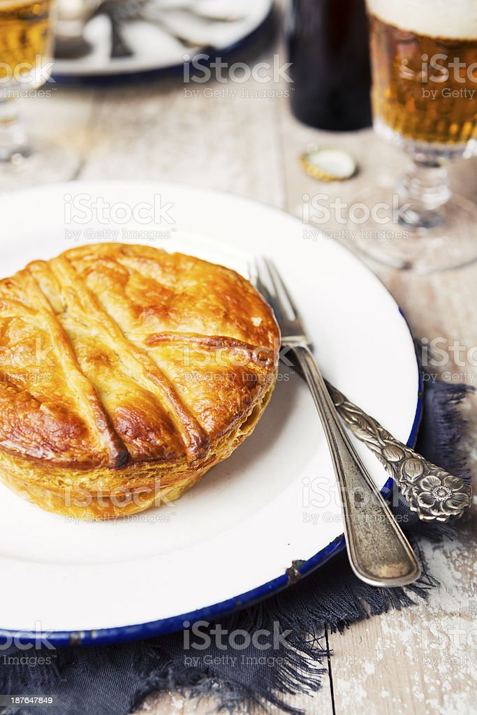 Homemade meat pie and beer on a rustic table royalty-free stock photo
