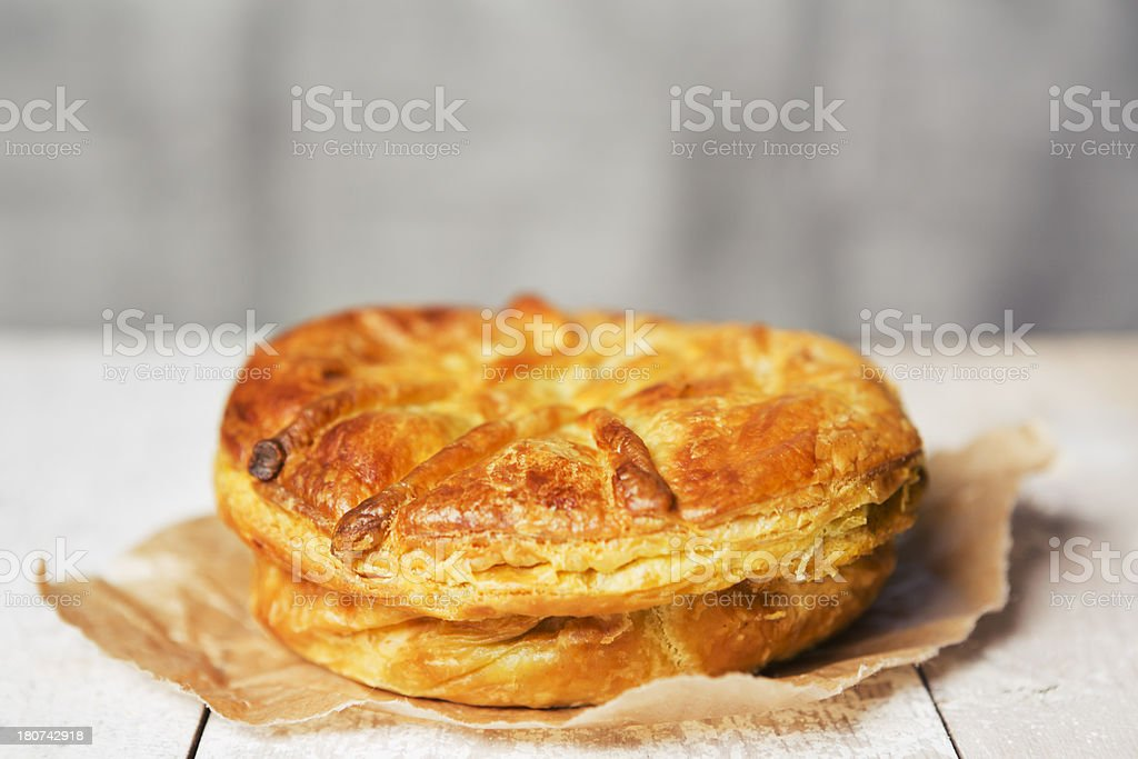 Homemade meat pie on a rustic table stock photo