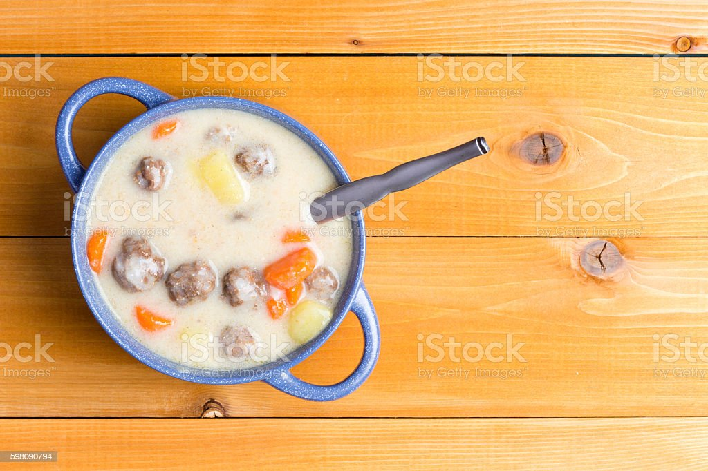 Homemade meatball soup with fresh vegetables stock photo