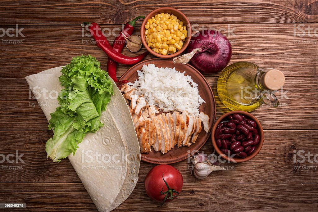 Homemade mexican chicken burrito . stock photo