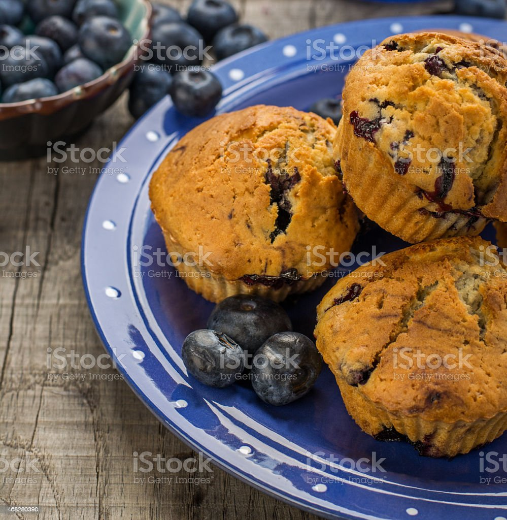Homemade muffins with blueberries on a wooden background stock photo
