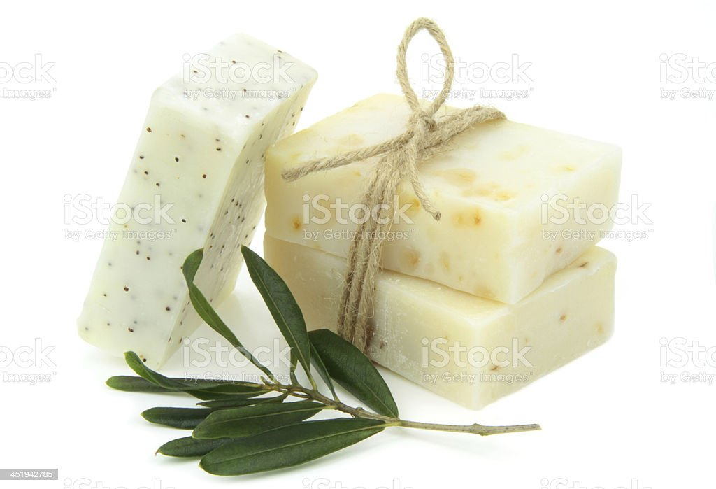 Homemade natural soap with olive, daphne and poppy seeds stock photo
