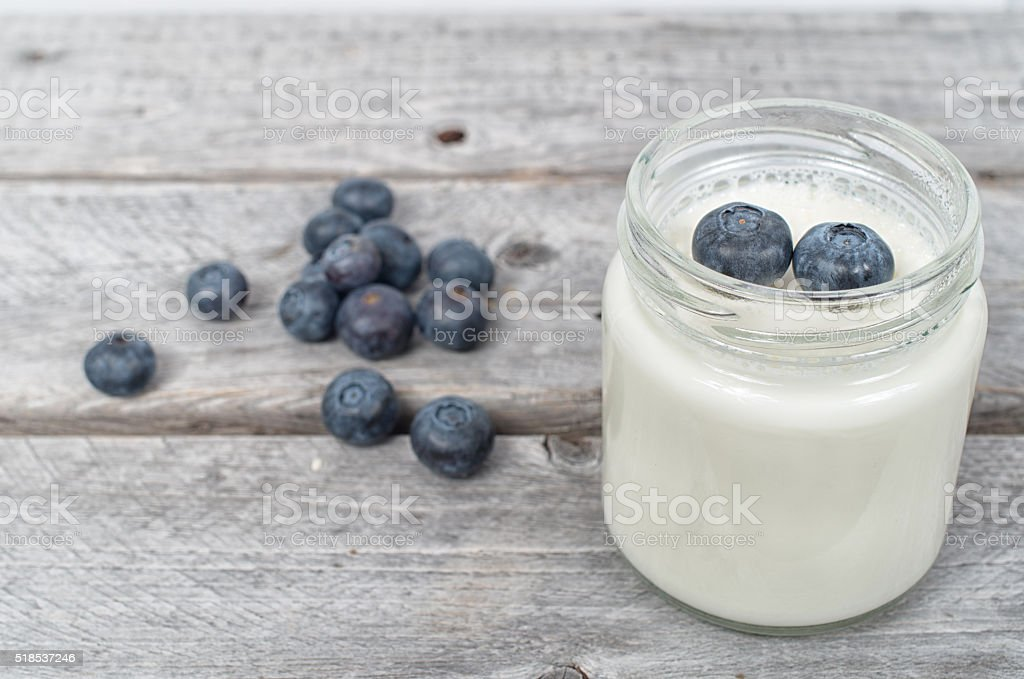 Homemade natural yogurt with blueberries fruits stock photo