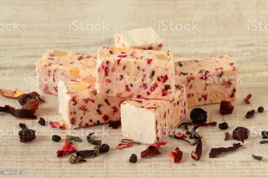 Homemade nougat with red dried fruit stock photo