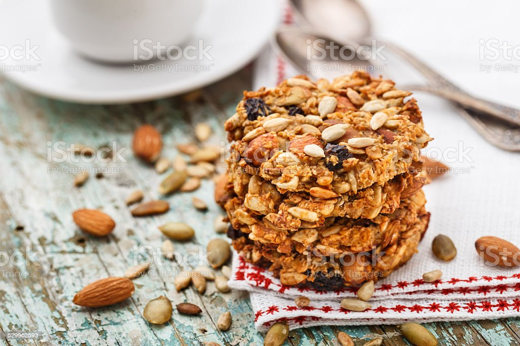 Homemade oatmeal cookies with seeds and raisin stock photo