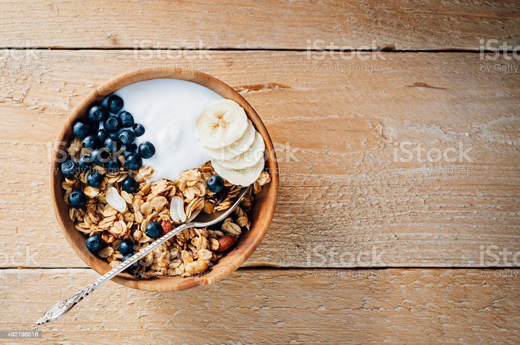 Homemade oatmeal granola with peanuts, blueberry and banana stock photo