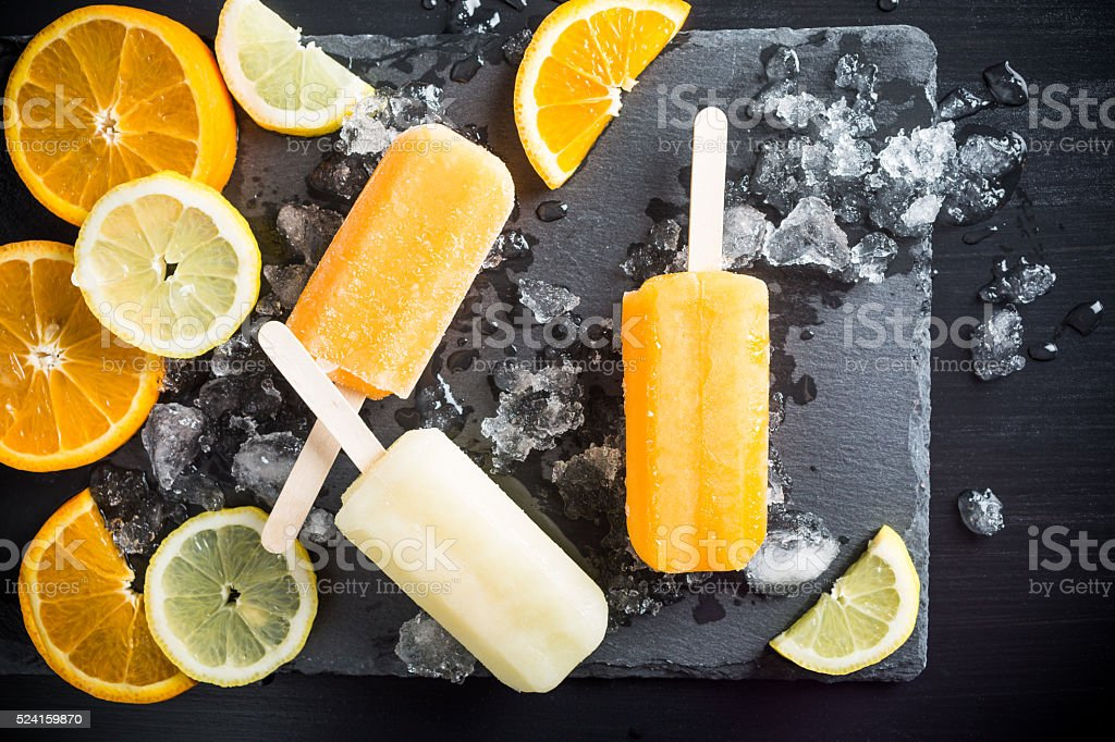 Homemade orange and lemon popsicles stock photo