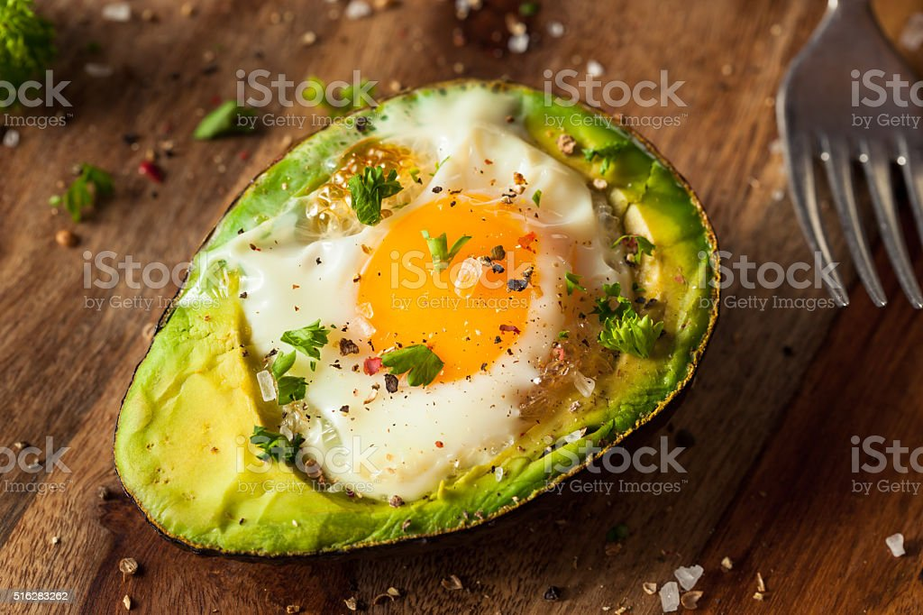 Homemade Organic Egg Baked in Avocado stock photo