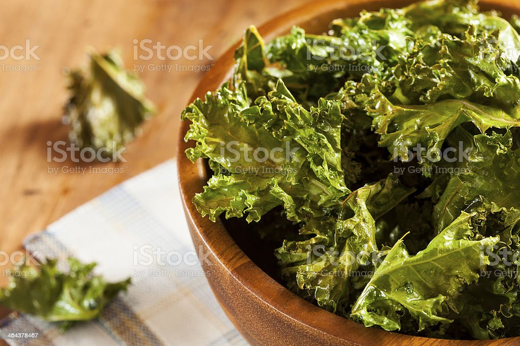 Homemade Organic Green Kale Chips stock photo