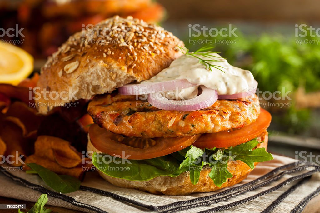 Homemade Organic Salmon Burger stock photo