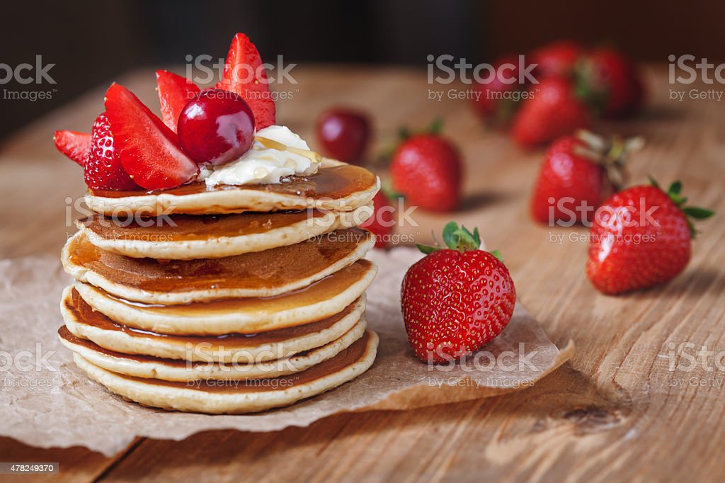 Homemade pancakes delicious breakfast or lunch dessert with strawberry, honey stock photo