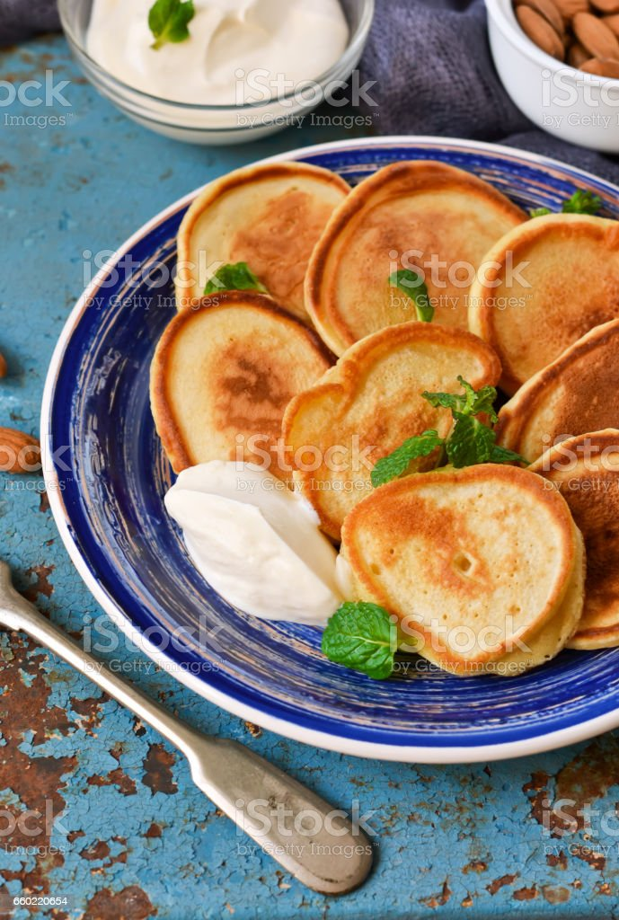 Homemade pancakes with sour cream and honey for breakfast stock photo