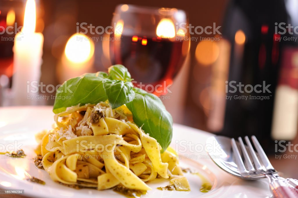 Homemade pappardelle with pesto and parmesan cheese royalty-free stock photo