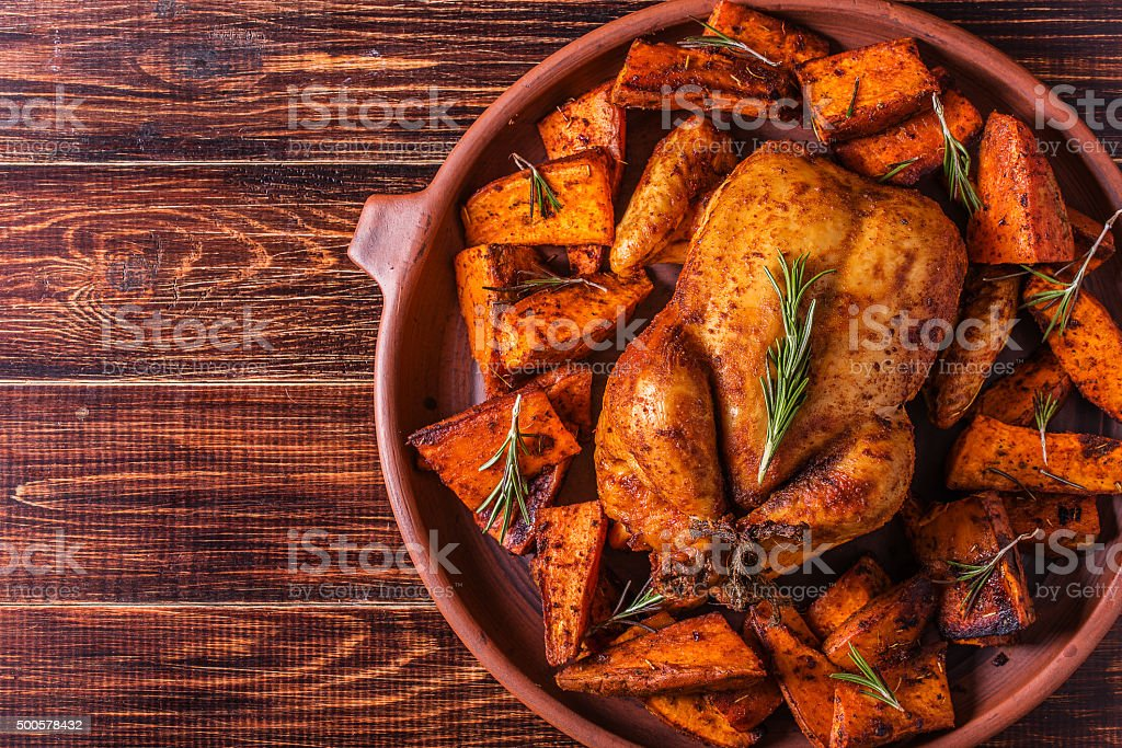 Homemade Paprika and Herb Whole Chicken with spices Sweet Potato stock photo