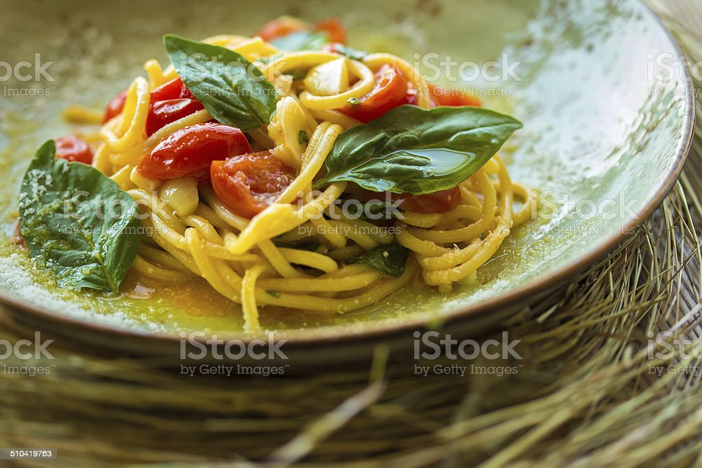 Homemade pasta with Basil and tomatoes stock photo