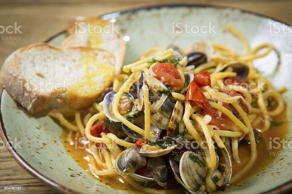 Homemade pasta with seafood and cherry tomatoes stock photo