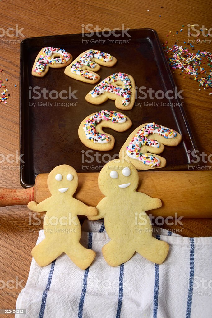 Homemade Peace Sugar Cookies With Gingerbread Men Holding Hands stock photo